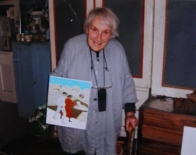 Photo of Mary Fedden with the Painting Julian and I, at her home
