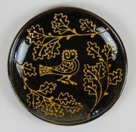 Circular slipware pressed owl dish