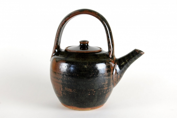 Teapot, overhead handle, tenmoku glaze by Jim Malone