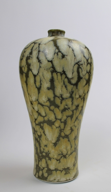 Medium pinched neck baluster bottle. Blossom design, iron glaze and celadon markings by Ivar Mackay