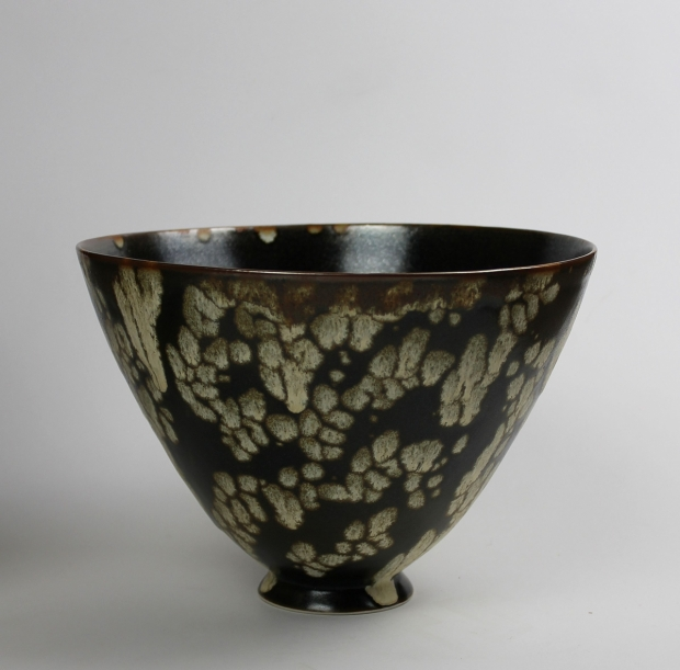 Tall flared footed bowl. Dappled Light II. Tenmoku glaze, cream markings, iron break at rim by Ivar Mackay