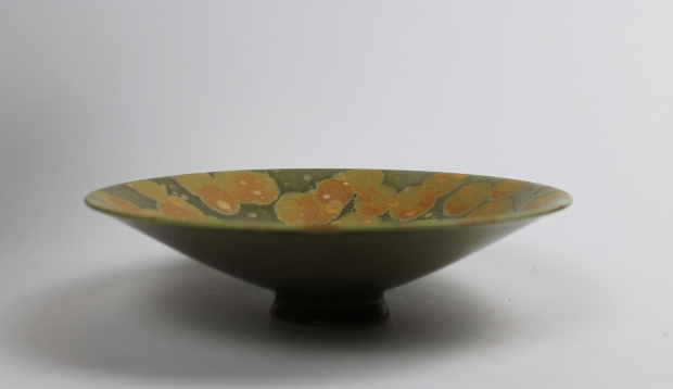 Medium low flared bowl with spotted iron glaze by Ivar Mackay