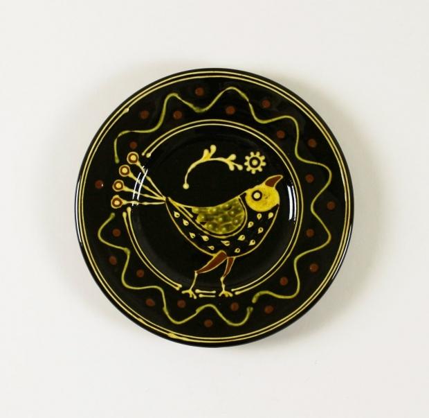 Small black slip-trailed bird plate by Hannah McAndrew