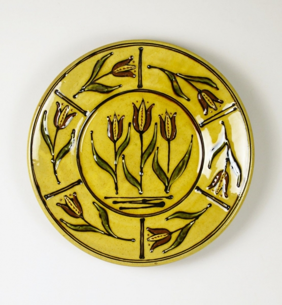 Large yellow slip-trailed tulip plate by Hannah McAndrew