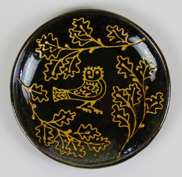 Circular slipware pressed owl dish by Hannah McAndrew