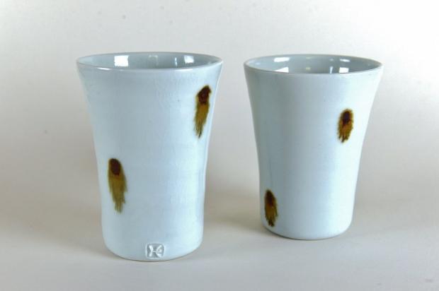 Pair of porcelain beakers by Edward Hughes