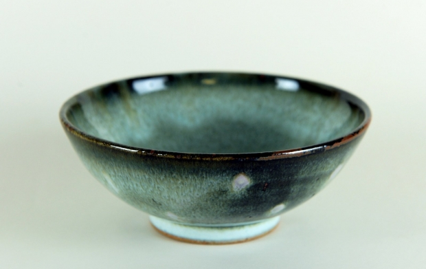Small green mottled bowl by Edward Hughes