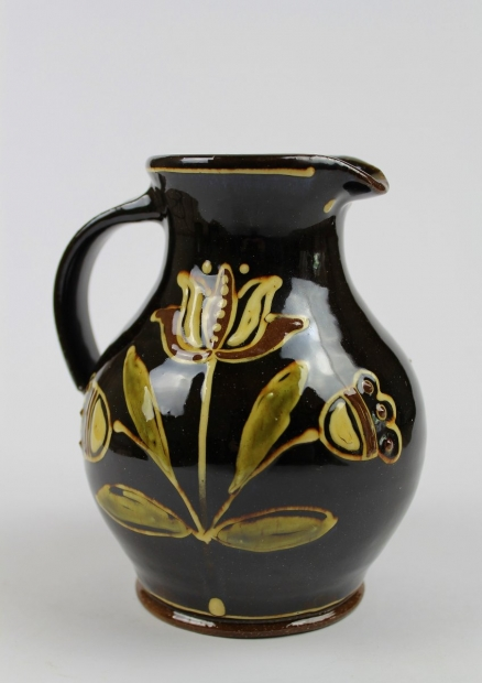 Small slip-trailed black tulip jug by Hannah McAndrew