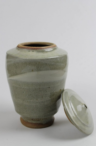 Tall lidded caddy, whit slip and green ash glaze by Tim Lake